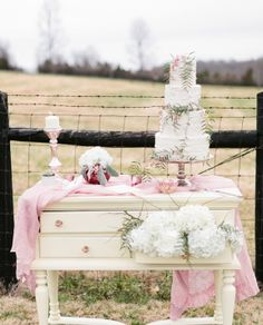 My vintage white table will be perfect for the cake table but how cute would it be to stuff the top drawer with baby's breath?