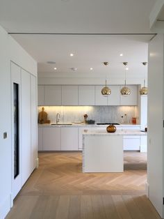 Classic palette: Twenty satin lacquer, Carrara marble.... Oak flooring and brass accents..