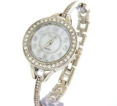 Stylish Silver Tone Round Ladies MOP Dial Analog Bracelet Watch Japan Movement Xanadu. $18.00. Japanese fine-tuned mechanics: precise quartz movement. Sparkling crystals made with SWAROVSKI elements adorning entire case with Mother-of-Pearl dial!. Features scratch resistant mineral glass and 3-hands movement. Perfect jewelery watch for any occasion!. The ALL NEW Xanadu designer series: elegant and unique!