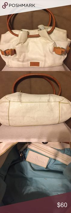 Leather Cole Haan Purse Genuine Leather Cole Haan Purse. Cream with brown accents and handles. Yellow trim edges of Purse. Silver hardware. Tiffany Blue lining inside the purse. Still has life in it for someone who could treat the leather and clean the inside. I do have the matching wallet available too just haven't listed it yet. If interested message me. 14x7x10 Cole Haan Bags