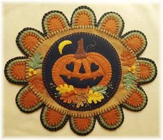 Who doesnt fall in love with Fall? This fun jack-o-lantern sure does! The completed mat measures 10 1/2 by 12 1/2 and can be stitched up in no time using wool felt or wool. Display on a table or hang on a wall and enjoy! Kits are available here: Penny Rug Patterns, Wool Applique Patterns, Felt Applique, Block Patterns, Quilt Patterns, Manualidades Halloween, Wool Embroidery, Penny Rugs, Felt Crafts