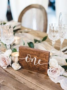 Wooden hand-calligraphed table number: http://www.stylemepretty.com/2017/03/10/blending-organic-and-elegant-in-the-most-beautiful-of-ways/ Photography: Krista A. Jones - http://kristaajones.com/