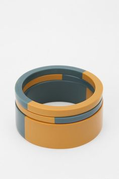 Love these bangles!  They look like bakelite, but they are not