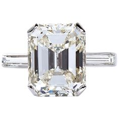 5.11 Carat Emerald Cut Diamond Platinum Engagement Ring | From a unique collection of vintage engagement rings at https://www.1stdibs.com/jewelry/rings/engagement-rings/