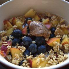 Greek yogurt (proyo) topped with nectarine, blueberries, granola & cinnamon raisin nut butter