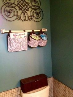 Oh Snap Bins and Oh Snap Pocket in the powder room to keep supplies within easy reach