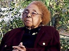 Rosewood survivor Robie Mortin, 93, at the Rosewood Cemetery upon her visit there with Marvin Dunn in 2008. (Photo courtesy of the Dunn Collection)