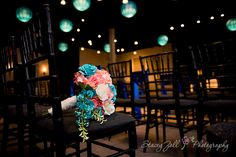 Teal & coral wedding colors / Bride bouquet / Reception venue with blue lighted globes | Kansas Wedding Photographer | Stacey Zoll Photography Manhattan, KS | staceyzphotography.com