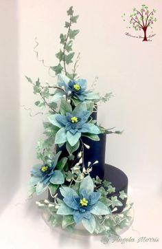Winter Poinsettia Wedding Cake by Blossom Dream Cakes - Angela Morris - http://cakesdecor.com/cakes/267078-winter-poinsettia-wedding-cake