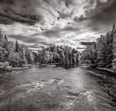 Drama. Dramatic clouds gets even more dramatic in Black & White!  #sky #clouds #sun #sunset #evening #day #autumn #fall #water #river #stream #waterfall #cliff #rocks #trees #leaves #light #black #bw #b&w #blackandwhite #view #landscape #sweden #jani #canon #drama #gray #shine #photo