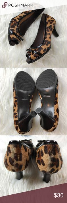 """Nurture Leopard Print Calf Hair Comfort Heels These heels are incredibly comfortable. The sole is cushioned. They are a peep toe style with a patent style bow on the toe. Calf hair leopard print. The calf hair is in tact and looks very nice. Gently used with no flaws. 3"""" heel. Nurture Shoes"""