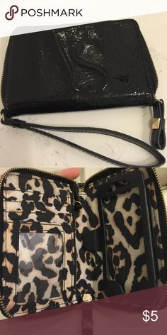 Victoria's Secret Black Wristlet This cute wristlet was my go to for any night out! It was perfect when I had an IPhone 5, as it fits that size phone and smaller. But now I have a 6 Plus and my phone is way too big!  This little purse can hold 4 cards, has a little pocket for cash or your keys (also fits a lipstick), and the phone holder for iPhone 5 size. Victoria's Secret Bags Clutches & Wristlets