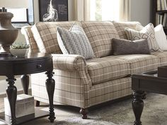 The Carlisle Sofa by Bassett Furniture features a semi-attached back with a graceful roll, classic round setback panel arms and elegant turned legs.
