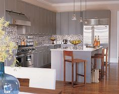 Suzie: Betty Wasserman - Gray modern kitchen design with painted gray kitchen cabinets with ...  I think this is it for the counter tops and backsplash!!!!!!!!!!!!