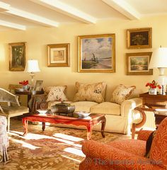 Bunny Williams ~ The sunny yellow living room is comfortably furnished