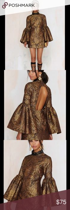 #123🐶🦃 NastyGal Go For Baroque Bell Sleeve Mini Always go for baroque. This dress is black and features gold and burgundy textured baroque print, mock neck with black beading and hook closure, bell sleeves, cutout and zip closure at back, and mini silhouette. We love it with mules and a box clutch. By Nasty Gal.  *Polyester/Cotton/Metallic  *Runs true to size  *Dry clean only  *Imported Nasty Gal Dresses