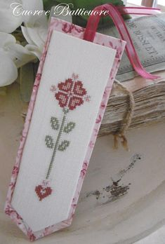 So, as promised, I will share my step by step instructions for how to back a cross stitch bookmark. Cross Stitch Freebies, Cross Stitch Bookmarks, Cross Stitch Books, Just Cross Stitch, Cross Stitch Finishing, Cross Stitch Heart, Cross Stitch Designs, Cross Stitch Patterns, Cross Stitching