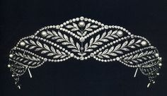 A diamond and natural pearl belle epoque tiara, circa 1890. Designed as a series of twelve arching leaf fronds, each with a pearl at it's end as a flower head, and divided from each other by a string of diamonds, topped with a central leaf sprig and pearl.