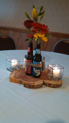 Beer bottle centerpiece I made for my brother's rehearsal dinner....