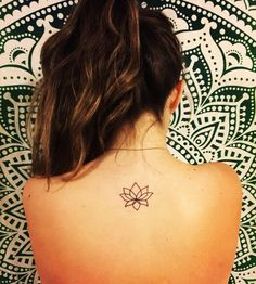 simplistic lotus tattoo on upper back                                                                                                                                                                                  More