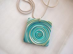 String pendant turquoise and gold sold | Just polymer clay. | Diane Keeble | Flickr