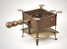 """A convenient heat source for home or camp often used by soldiers; this example with robustly turned handle measures: (H: 8""""; W: 9.25""""; D: 16"""".)  $985"""