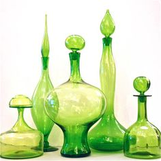 "A refreshing collection in a zesty lime green coloration. All by Blenko, with the exception of the squat decanter at the very left, which is by Greenwich Flint Craft. Heights range from 11""- 25"""