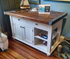 (Click to enlarge) Custom built WWII Liberty Ship Center Island Hatch cover top 75+ years old Native hardwood cabinetry Dovetail drawer construction Soft close drawer runners Choice of stains and f…