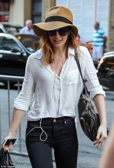 Staying hidden: Leighton went incognito in a straw hat and large brown sunglasses...