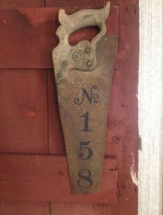 House numbers on vintage hand saw