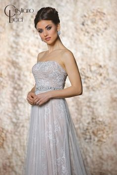 12940/Madeline This classic strapless A line gown with tulle overlay  lace sparkles with detachable beaded capelet and waist belt Fabric: Tulle+Lace+Satin Available Color: Ivory/Champagne, Ivory/Ivory White/Champagne, White/White