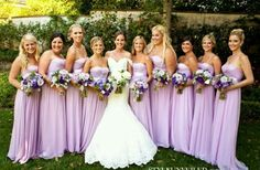 Balance... I would have done mostly white bouquets with a dark purple and cream colored ribbon accent
