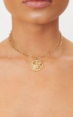 Chaîne ras-de-cou dorée à pendentif piècette