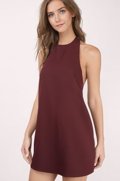 Live for the night in the Revelry Halter Shift Dress. A sophisticated high neck dress with a sleek silhouette and slight swing in the hem. It's an ope Burgundy Maxi Dress, Girls Frock Design, Dress Up, High Neck Dress, Frocks For Girls, Homecoming Dresses, Halter Dresses, Shift Dresses, Open Back Dresses