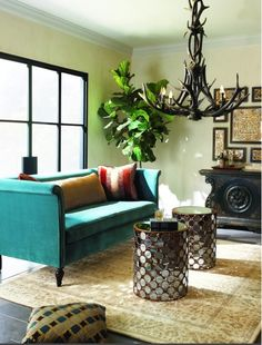 Teal sofa, coffee table stools, natural chandelier..love!!