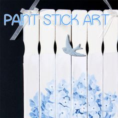 "Paint Stick Art Tutorial  Neat idea to surround a cheap ugly plastic planter.  Also nifty way to make a simple wall hanging or hanging tree ornament with ""L"" or some cute french word art."