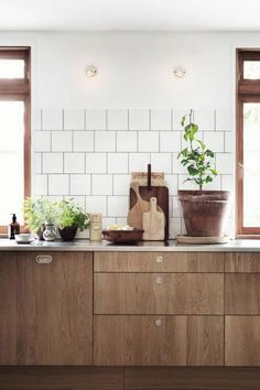 Modern wood cabinets and white backsplash
