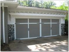 Small pergola over garage doors and under the eves. Hmmm....
