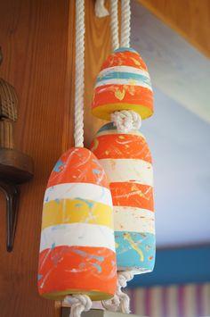 Painted buoys on Lisa Mende Design