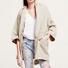 FREE PEOPLE Jacket Oversized Slouchy Wrap Coat Top Size M/L.  New with tags. $168 Retail + Tax.   • Gorgeous lightweight draped bomber jacket with optional drawstring waist and tie closure.  • Lightly worn-in distressed feel & vibe.  • Loose fitting and cape-like.  • Perfect for layering and transitioning into Fall. • Linen, cotton.  • Color: Tan.     {Southern Girl Fashion - Boutique Policy}   ✔️ Same-Business-Day Shipping (10am CT). ✔️ Reasonable best offer considered when submitted with…
