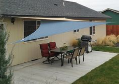 DIY: I'd use a waterproof cloth & sew that sucker up myself. Instructions, hardware, step by step photos. Cover Your Outdoor Space With Shade Sails