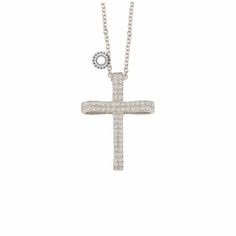 Ένας μοντέρνος γυναικείος ή βαπτιστικός σταυρός από λευκόχρυσο Κ14 γυριστός σαν κορδέλα, γεμάτος ζιργκόν και ενσωματωμένος σε αλυσίδα.