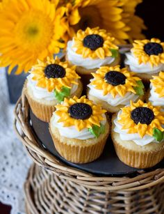 These cupcakes look amazing! What makes them even more amazing is that they have sunflowers on top!!! My favorite type of flower ever! :)