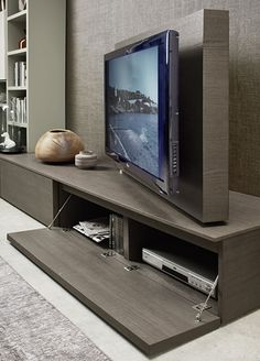 This swivel TV feature with hidden media storage on the Kronos is ideal for all living spaces for a minimalist design. Available from IQ Furniture. Tv Unit Design, Tv Wall Design, Tv Furniture, Living Room Furniture, Furniture Buyers, Living Room Tv, Living Spaces, Swivel Tv Stand, Tv Swivel Mount