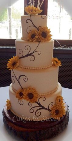 Hand painted sunflower wedding cake by Cakes by Susan.