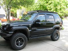 Perfect roof rack concept of what I want to make. Jeep Zj, Jeep Cars, 2006 Jeep Liberty, Overland Truck, Black Jeep, Cool Jeeps, Jeep Stuff, Jeep Cherokee, Roof Rack