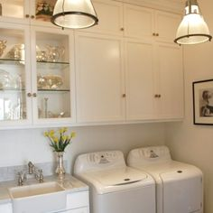 LOVE this laundry room... esp the lights.