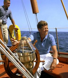 President John F Kennedy on a sailboat near the Kennedy compound in Massachusetts.