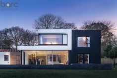 A simple and bold contemporary family house that encourages outdoor living and maximises views of their spacious garden. We designed a crisp, light filled building, simple yet self assured in form and one of the few contemporary buildings in Plymouth. Barc worked very closely with the client in developing the brief and then the design. Photography by Justin Foulkes.