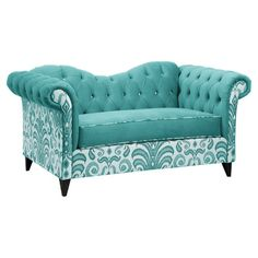 Lend a touch of elegant whimsy to your parlor or den with this button-tufted settee, showcasing a lovely teal hue and a paisley motif.